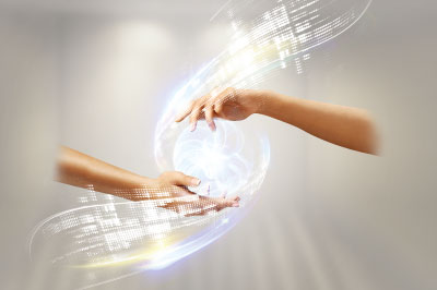Abstract image of two hands holding a ball of light
