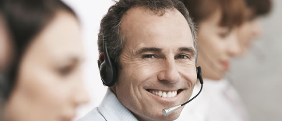 a smiling man wearing a headset