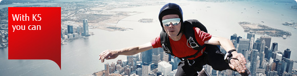 Photo of a person skydiving over a city. With K5 you can. Do incredible things with Fujitsu Cloud Service K5.