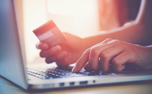 Photo of person paying for something online by credit card