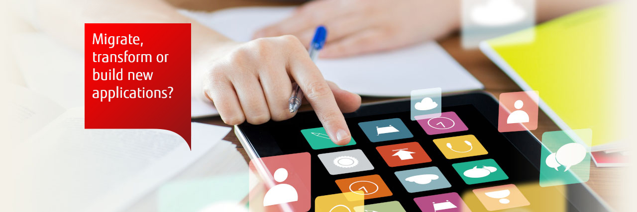 Photo of a woman selecting icons on a tablet screen