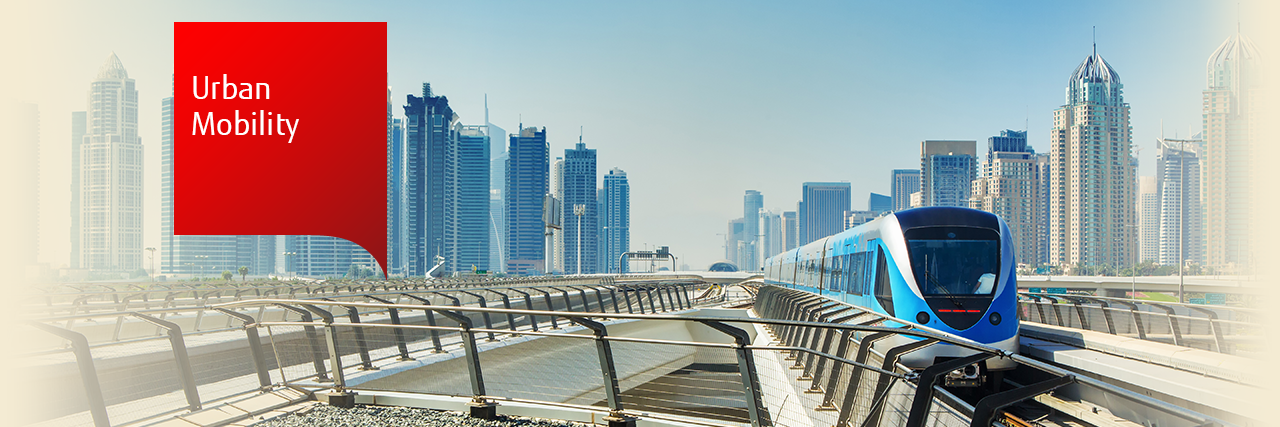Photo of automated metro train with Dubai city in the background