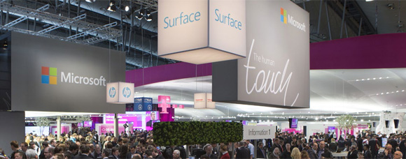 the Microsoft stand and a crowd of people attending the CeBIT event