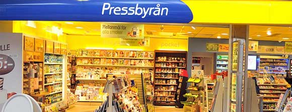 A Pressbyran store, brightly colored with displays of books and magazines