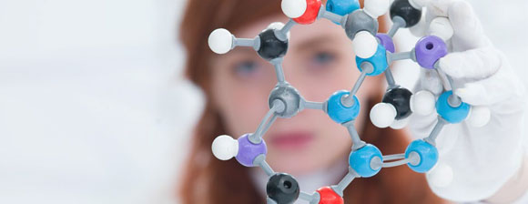 Scientist with a molecular model