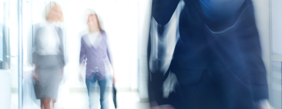 A blury effect image of 2 women walking
