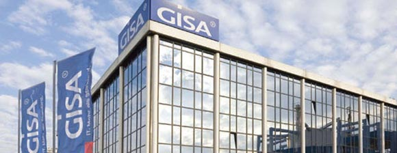 A glass office building with GISA signs and flags