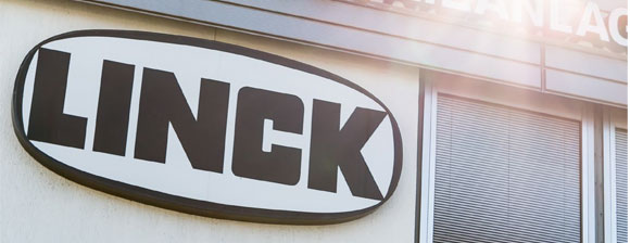 The Linck logo on a building sign