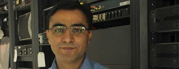 Ravinder Mawa standing in front of rack-mount servers