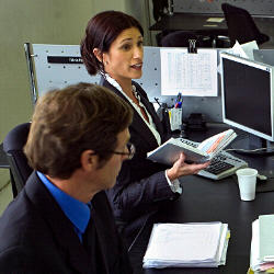photograph of man and woman working at a desk