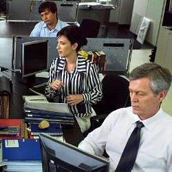 Photograph of people working in an office