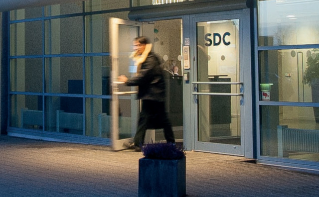 Photo of a man walking out of an SDC office