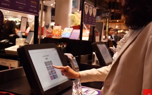Woman using a self service checkout - SIAM case study