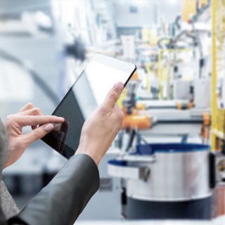 Person using a tablet in a factory - Supply Chain