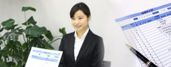 Smiling woman in an interview with a form in the foreground
