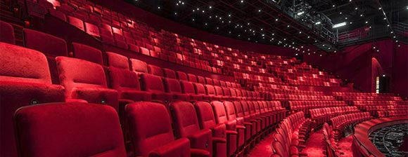Rows of deep red auditorium seating