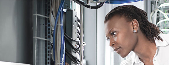 A woman examining network cabling