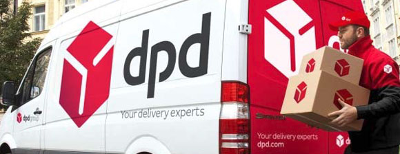A dpd driver carry packages from a dpd liveried van