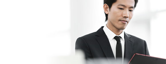Man in a black suit using a Fujitsu tablet