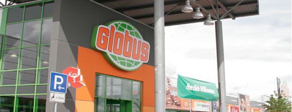 The front of a Globus store with their Orange and green Globus logo on a sign