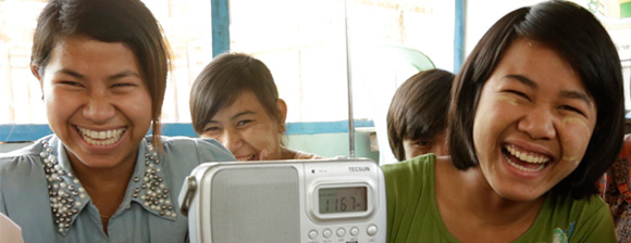 Girls smiling with a radio