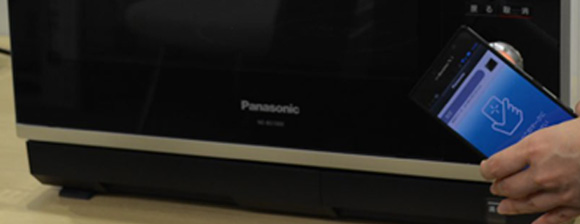 A black Panasonic microwave and a smartphone App