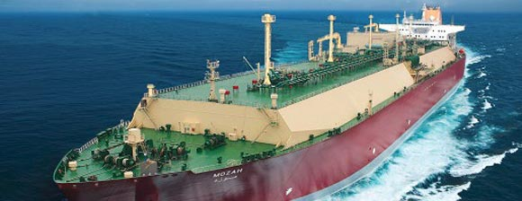 A large ship, the Liquid Nqtural Gas tanker - Mozah,  with a red hull and green and beige upper decks