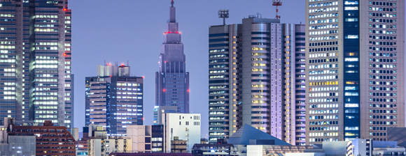 Evening city skyline image showing rooftops and skyscrapers