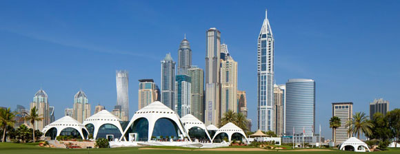 Dubai Golf Course against a backdrop of skyscrapers and a blue sky
