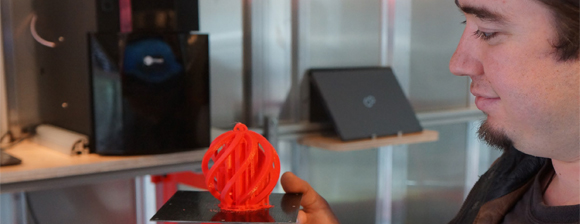 Man looking at 3D printed object