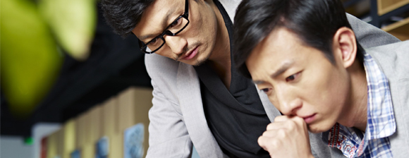 Two men concentrating