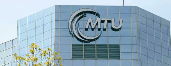 MTU Sign with logo on an angular glass building