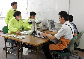Picture: Workers at Fujitsu Harmony Limited creating PDF files