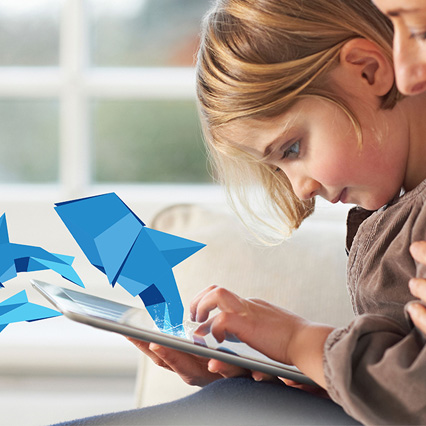 Girl using tablet with dolphin origami