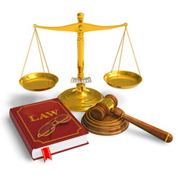 Photograph of book, scales and gavel