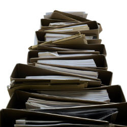 Photograph of a pile of paper files