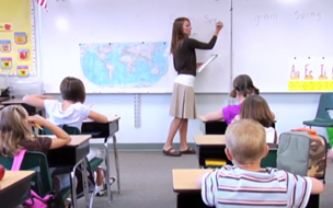 Woman teaching in a classroom - Illinois Century Network case study