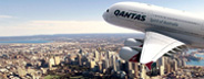 Quantas Airplane Flying Over a City