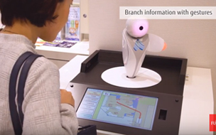 Woman looking at small robot - Taiwan FamilyMart case study