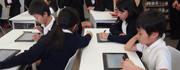 Japanese school children in a classroom using Fujitsu Stylistic tablets