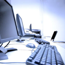 Photograph of computers on desk