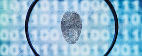 magnifying glass looking at a finger print
