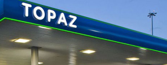 section of a TOPAZ petrol station roof with TOPAZ logo