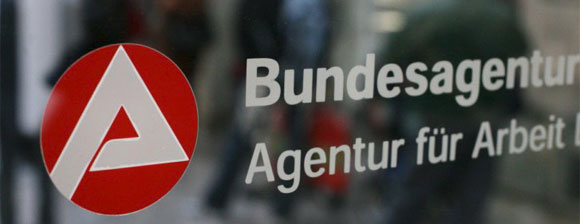 Sign on a glass door that reads 'Bundesagentur Agentur für Arbeit'